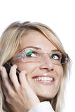Smiling woman using a mobile phone Stock Photos