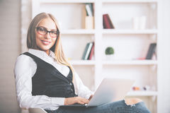 Smiling woman using notebook Stock Image