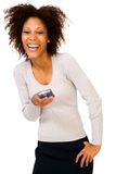 Smiling woman using PDA Royalty Free Stock Images