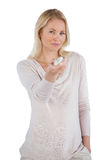 Smiling woman using remote control Royalty Free Stock Image