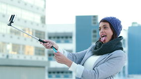 Smiling woman using selfie stick stock footage