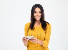 Smiling woman using smartphone Stock Image