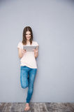 Smiling woman using tablet computer Stock Image