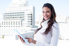 Smiling woman using tablet pc Stock Image