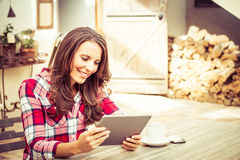 Smiling Woman Using Tablet Stock Photos