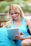 Smiling woman using touchpad Stock Photography