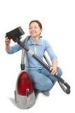 Smiling Woman vacuuming Stock Photo
