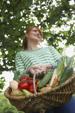 Smiling Woman With Vegetable Basket Stock Photo