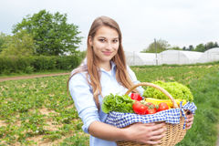 Smiling woman with vegetables fresh from the farm Stock Photo