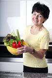 Smiling woman with vegetables Royalty Free Stock Image