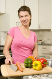 Smiling woman with veggies Royalty Free Stock Photos