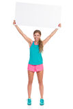 Smiling Woman In Vibrant Clothes Holding Blank Banner Above Head Royalty Free Stock Image