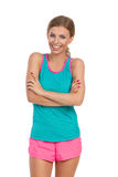 Smiling Woman In Vibrant Sports Clothes With Arms Crossed Stock Photography