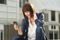 Smiling woman on video chat with mobile phone Stock Photos