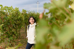 Smiling Woman in Vineyard Stock Image