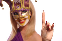 Smiling woman in violet mask Stock Photography