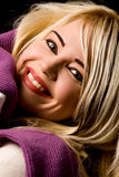 Smiling woman with violet scarf Stock Images