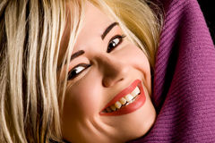 Smiling woman with violet scarf Stock Photo