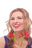 Smiling woman with vivid fresh flowers Royalty Free Stock Images