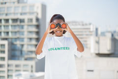 Smiling woman with volunteer tshirt using binoculars Royalty Free Stock Images