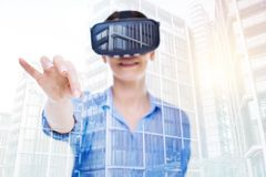 Smiling woman in VR headset holding fingers in pinch Stock Photos