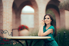 Smiling Woman Waiting for an Important Date at a Restaurant Table Royalty Free Stock Photos
