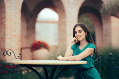 Smiling Woman Waiting for an Important Date at a Restaurant Table Royalty Free Stock Image