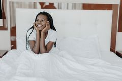 Smiling woman waking up in her bedroom. Wake up concept. Smiling woman waking up in her bedroom royalty free stock image