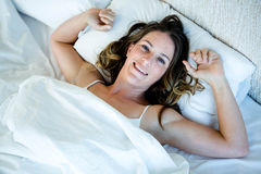 Smiling woman, waking up in the  morning Royalty Free Stock Photo