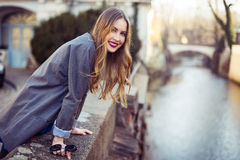 Smiling woman walking in the city near river embankment Stock Photography