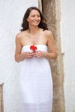 Smiling woman walking with flower Royalty Free Stock Photos