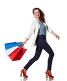 Smiling woman walking with French flag colours shopping bags Royalty Free Stock Photo