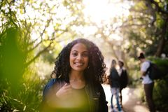 Smiling woman walking in park royalty free stock photo