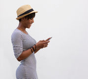 Smiling woman walking and reading text message Stock Image