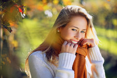 Smiling woman in warm autumn light. Beautiful smiling woman in warm autumn light . Seasonal backlit portrait royalty free stock photography