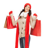 Smiling woman in warm clothers with shopping bags Royalty Free Stock Photography