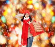 Smiling woman in warm clothers with shopping bags Royalty Free Stock Image