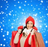 Smiling woman in warm clothers with shopping bags Stock Image