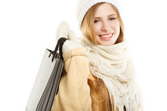 Smiling woman in warm clothing with bag Stock Photography