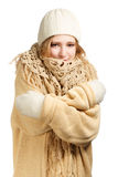 Smiling woman in warm clothing hugging herself Royalty Free Stock Photography