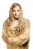 Smiling woman in warm comforter Stock Images