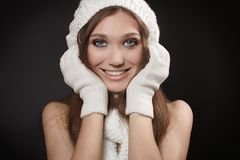 Smiling woman in warm hat and winter gloves Stock Photos