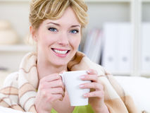 Smiling woman warming with cup Stock Photography