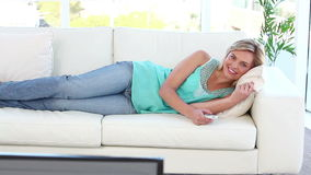 Smiling woman watching the television stock video