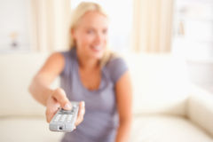 Smiling woman watching TV Stock Photography