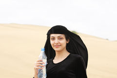Smiling woman with water bottle Stock Photography