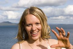 Smiling woman waving Stock Photos