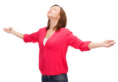 Smiling woman waving hands with closed eyes Royalty Free Stock Photo