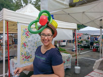 Smiling Woman Wearing Balloon Hat Royalty Free Stock Photo