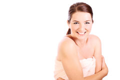 Smiling woman wearing bath towel Stock Photos